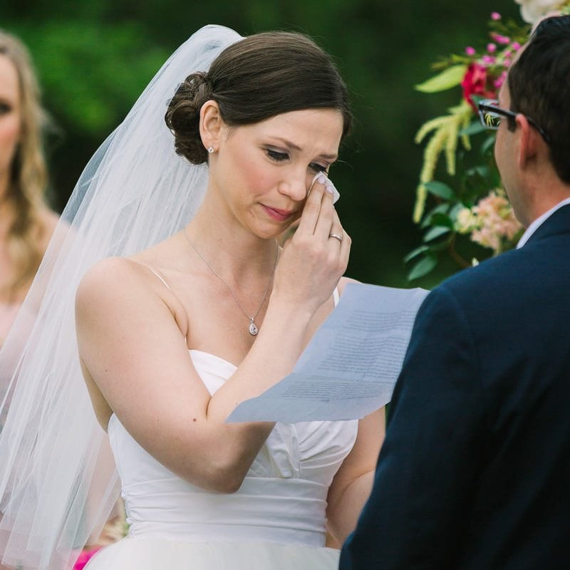 bride cries while she recites her wedding vows