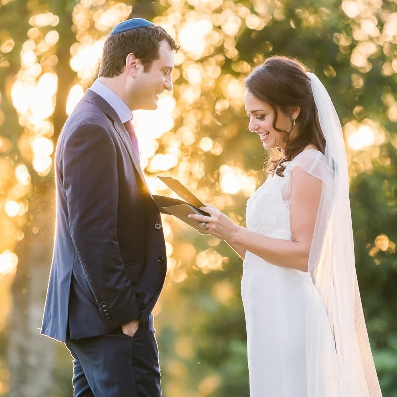 bride reads groom note as they share a private moment