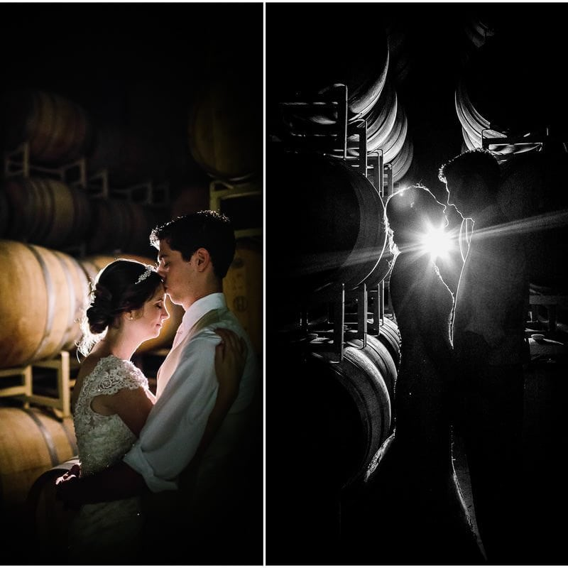 Night photo of Bride and groom in barrel room of distillery