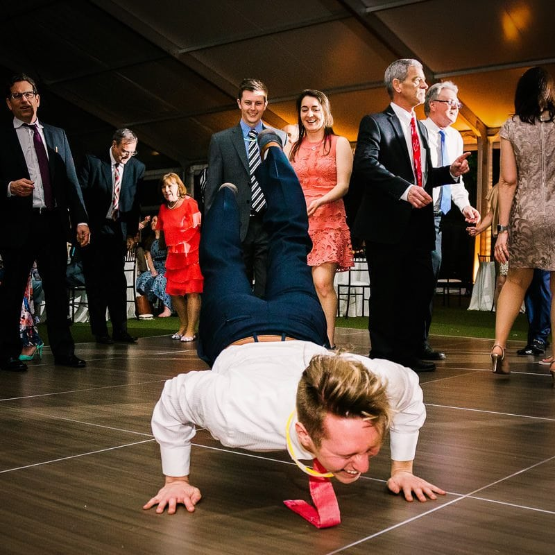 Wedding guest does the worm dance at reception