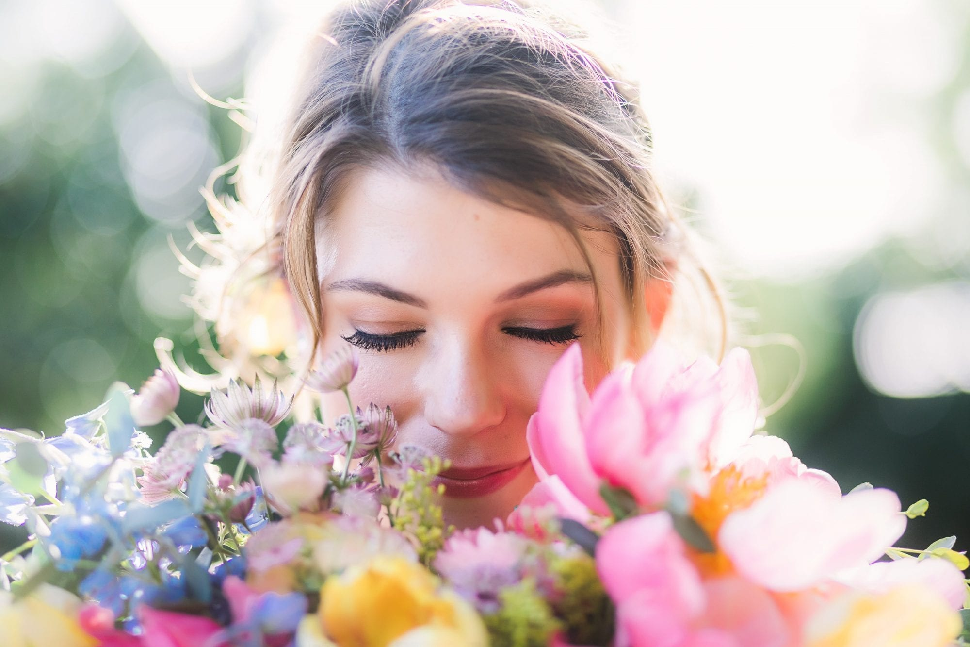 Photograph of Bride smelling her flowers