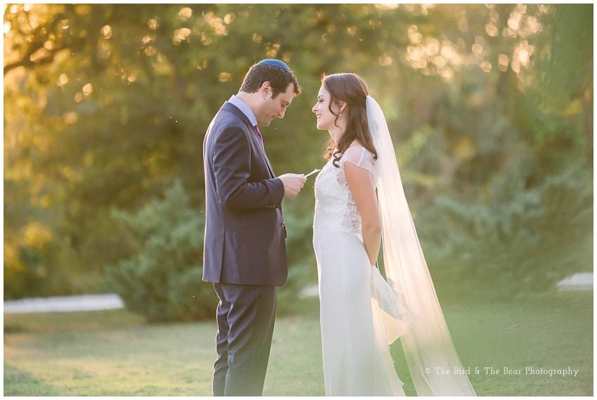 Groom reads a note to his bride while they share a private moment
